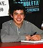 David at signing table