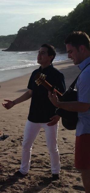 Costa-Rica-David-singing-blue-shirt-white-pants